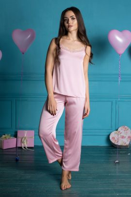 Picture of light comfortable satin ladies pajamas with top and pants with lace trim.