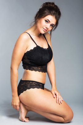Photo of a wireless longline soft black lace bralette with padded cups.