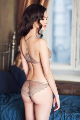 Image of a gorgeous unlined nude lace bralette and low-rise lace panties.