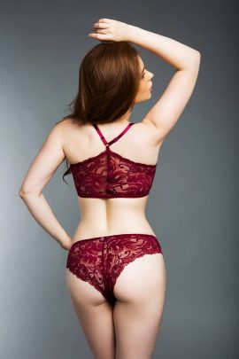 Photo of a padded racer back burgundy lace bralette and high-waisted knickers.