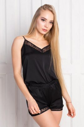Picture of a silky black satin pajama set with shorts and lace trim