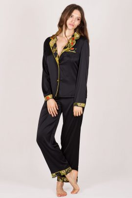 Picture of a soft black satin pyjamas with pants and long sleeved shirt.